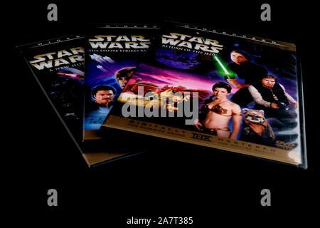 Star Wars trilogy or prequel dvds; episodes four through six (IV, V, VI). - Stock Photo