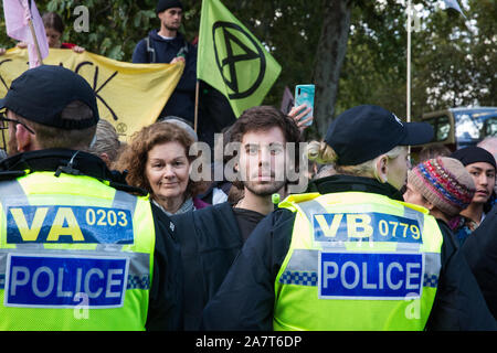 London, UK. 13 October, 2019. Extinction Rebellion climate activists protest in solidarity with disabled colleagues outside New Scotland Yard. Credit: - Stock Photo
