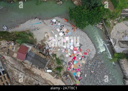 Chinese villagers put their clothes, sheets, and quilts under the sun after floodwater due to heavy rainstorm caused by the Typhoon Lekima, the 9th ty - Stock Photo