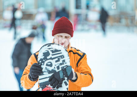portrait of young caucasian man with snowboard - Stock Photo