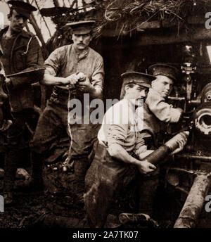 British troops loading an Ordnance QF 18-pounder,the standard British Empire field gun of the First World War-era during the Battle of Armentières fought by German and Franco-British forces in northern France in October 1914, during reciprocal attempts by the armies to envelop the northern flank of their opponent, which has been called the Race to the Sea. - Stock Photo