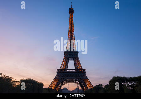Paris, France - September 21, 2019: View of Eiffel tower, view from Champ de Mars in the twilight with a blue sky in a background, in Paris, France. - Stock Photo