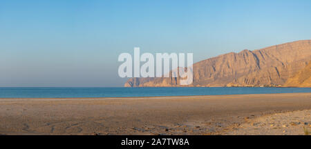 Panorama of ge town of Bukha Beach view to the Musandam Mountains in Oman at sunset. - Stock Photo