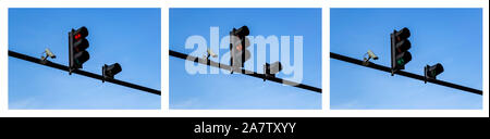 Set of red, yellow and green traffic lights and outdoor surveillance camera installed on a pole above a roadway. Modern automatic traffic control. - Stock Photo