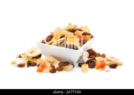 Dried fruits in white bowl on white background - Stock Photo
