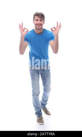 smiling modern guy showing OK gesture. isolated on white - Stock Photo