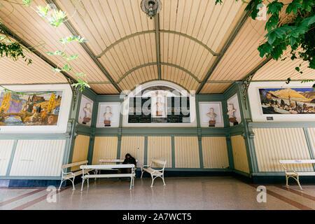 MERANO, ITALY - JULY 20, 2019 - The Wandelhalle covered passageway in Merano Winterpromenade along the torrente Passirio - Stock Photo