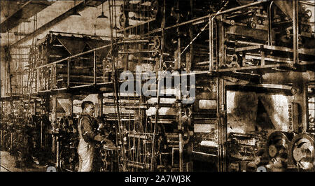 Printing press  1920s - A British newspaper press that could print 30,000 newspapers per hour with its 'minder' - Stock Photo