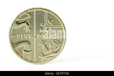 Five British pence coin isolated on white background