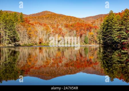 Fall color reflections at Balsam Lake - Roy Taylor Forest in the Nantahala National Forest, Canada, North Carolina, USA