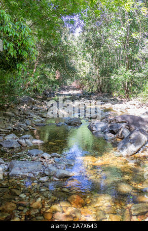 Mountain spring water, stream between rocks and stones, brook, creek. Thailand, island Koh Chang. - Stock Photo