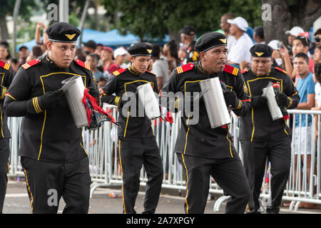 Young men in uniform playing instruments during parade at Flag Day, a national public holiday in Panama. - Stock Photo