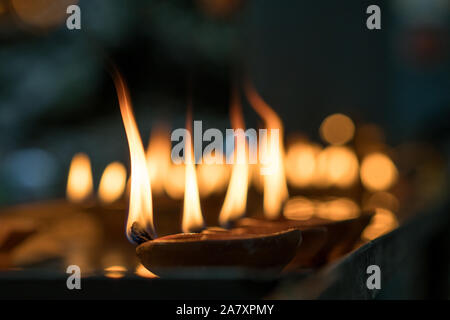 Oil lamp used during Hindu religious festival made of clay variety commonly found in homes and temple - Stock Photo