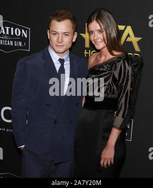 Beverly Hills, California - Nov 03, 2019:  (L-R) Taron Egerton and Emily Thomas attend the 23rd Annual Hollywood Film Awards at The Beverly Hilton Hot