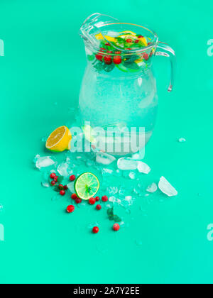 Fruit and berry lemonade drinks, refreshment infused water, in glass jars, with fresh cranberries, lemon and lime slices - Stock Photo
