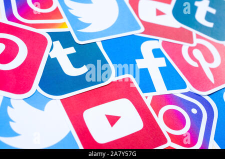 KHARKOV, UKRAINE - OCTOBER 3, 2019: Many social network printed icons lies in pile. Facebook Instagram Pinterest Twitter Youtube Tumblr. Abstract inte - Stock Photo