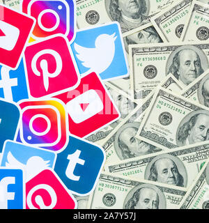 KHARKOV, UKRAINE - OCTOBER 3, 2019: Many hundred dollars bills with printed logo of social networks. Facebook Instagram Youtube Tumblr Twitter Pintere - Stock Photo