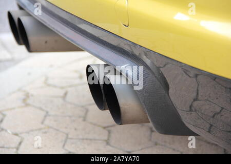 four exhaust pipes on a car - Stock Photo