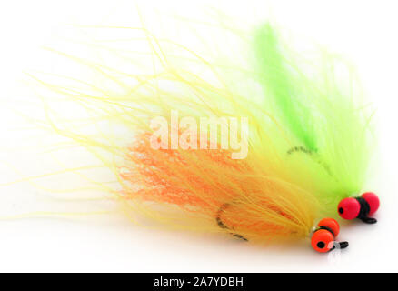 Fishing fly with hook over white background - Stock Photo