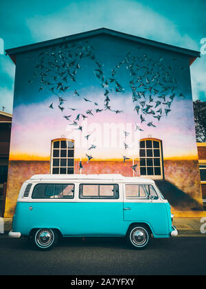 Port Adelaide, Australia - March 10, 2019: Classic Volkswagen camper van parked on a street near graffiti wall - Stock Photo