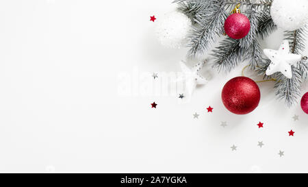 Christmas tree branch with red balls and white decorative stars isolated on white background. Xmas banner mockup wit copy space, winter holiday greeti - Stock Photo