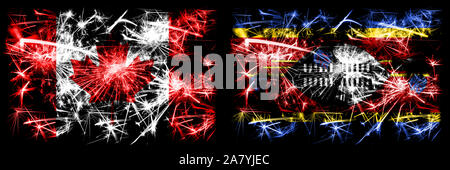 Canada, Canadian vs Swaziland, Swazi New Year celebration sparkling fireworks flags concept background. Combination of two abstract states flags. - Stock Photo