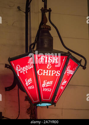 Fish & Chip Shop Sign - Old fashioned hanging sign outside Poppies fish and chips shop near Spitalfields Market in London's East End - Stock Photo