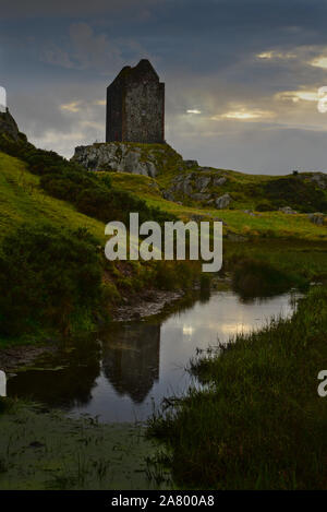 Evening setting over a brooding Smailholm Tower, near Kelso in the Scottish Borders - Stock Photo