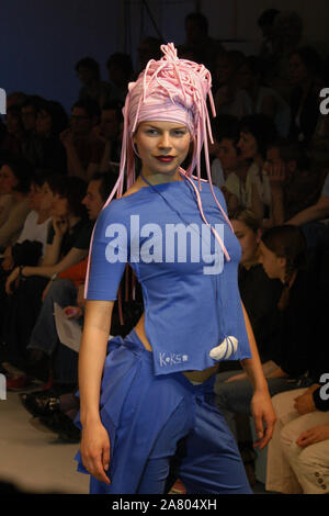 Female model displays a creation by Czech fashion designer Kateřina Hubálková during the Fashion Point Festival in Prague, Czech Republic, on April 16, 2005. - Stock Photo