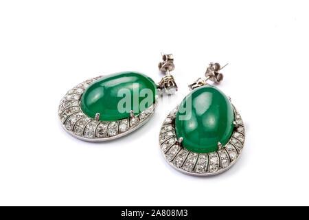 Jadeite jade and diamond earrings. - Stock Photo