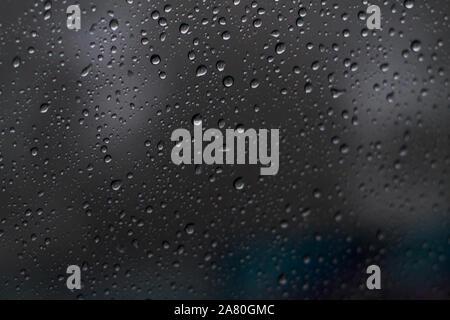 Raindrops on car windows - Stock Photo