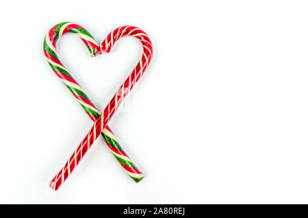 Christmas background. Two different Christmas candy canes on white backgroud. copy space - Stock Photo