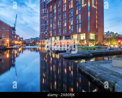 Modern hotel reflection in the canal at dusk at Granary Wharf Leeds West Yorkshire England Stock Photo