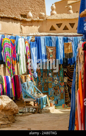 Souvenir shop and chilabas at the Kasbah Ait Ben Haddou in Ouarzazate, Morocco October 2019 - Stock Photo