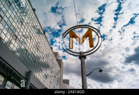 Paris, France - 3rd October, 2019: Looking up at Metro sign outside subway station in Paris, France - Stock Photo