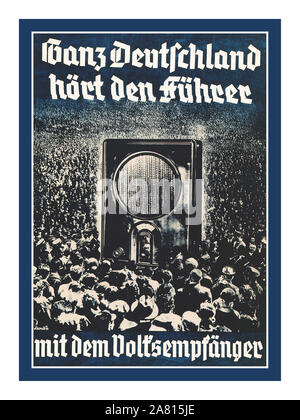"""1930's Vintage Nazi Germany Propaganda Poster pre-WW2 """"Ganz Deutschland hört den Führer mit dem Volksempfänger"""" """"….All over Germany hear the Führer with the people's radio receiver"""" 1936 Nazi Germany poster featuring crowds of Germans at a popular Nuremberg Rally surrounding a larger than life 1930's """"Volksempfänger VE301"""" radio receiver developed by Propaganda Minister Joseph Goebbels . - Stock Photo"""