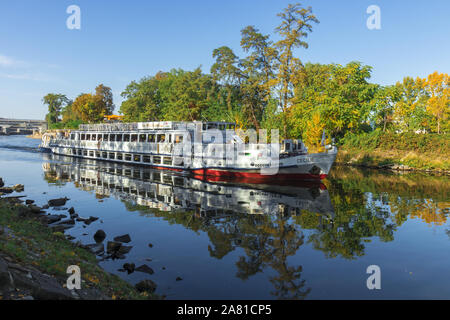 PRAGUE - October 13. River cruise CECILIE leaving lock on Vltava river nearby Stvanice island, on October 13, 2019 in Prague, Czech Republic. With blu - Stock Photo