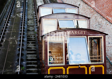 Budapest, Hungary - May 27, 2019: train going on a very steep hill up to the castle - Stock Photo
