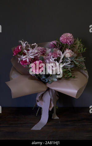 Close-up of bouquet decorated in vintage style on a dark background, selective focus - Stock Photo
