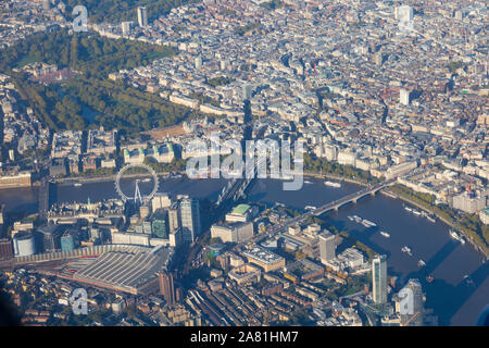 Aerial view over London with The Coca Cola London Eye, River Thames, Waterloo station, Charing Cross station, Buckingham Palace.England. UK - Stock Photo