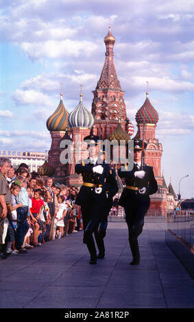 """Russian soldiers or """"Guard of Honor"""" march to the entrance of Lenin's Mausoleum, Tomb, in Red Square, Moscow, Russia. - Stock Photo"""
