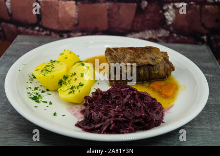 traditional german Food Beef Roulade with red cabbage - Stock Photo