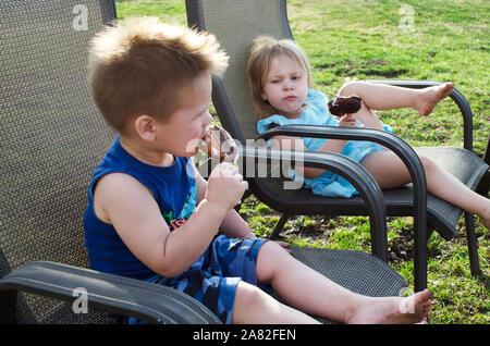 Children with attitude eating ice cream - Stock Photo