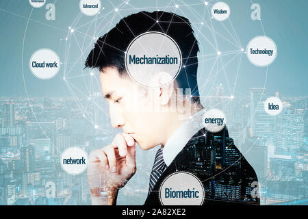 side view of businessman thinking overlay with cityscape - Stock Photo
