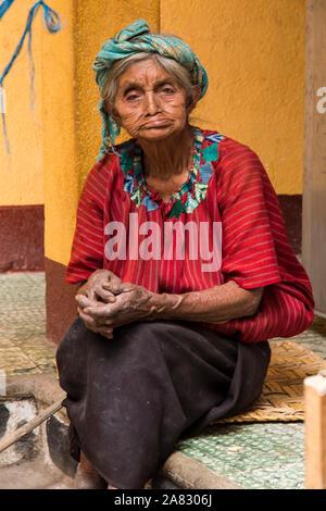A very old Guatemalan woman in traditional dress in Santa Cruz la Laguna, Guatemala.  Almost 90 years of age. - Stock Photo