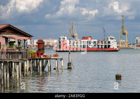 PENANG, MALAYSIA, NOV 12 2017, Regular ferry arrive to The Penang Island with  Clan Jetties of George Town. - Stock Photo