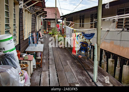 PENANG, MALAYSIA, NOV 12 2017, Narrow street at the wooden houses on pilots stand over the sea, Clan Jetties of George Town, Penang, Malaysia. - Stock Photo