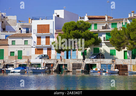Boat garages under former fishing houses, historic harbour of Porto Colom, Mallorca, Balearic islands, Spain - Stock Photo