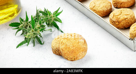 Cannabis butter cookies with marijuana buds and cannaoil, homemade healthy biscuits, close-up panorama with a place for text