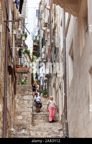 Classic vertical view of small alleyway in the old town of Dubrovnik,  Croatia - Stock Photo
